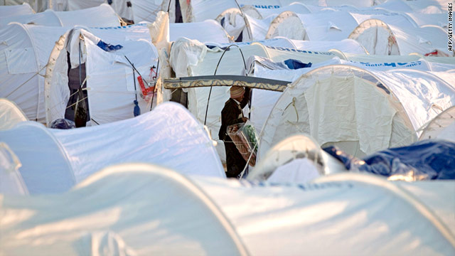 A man who fled from Libya makes his way Wednesday among scores of tents at a refugee camp in southeastern Tunisia.