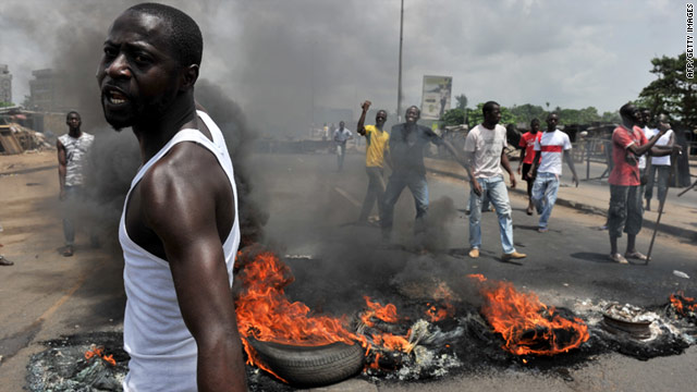 Residents blocked the street after Laurent Gbagbo's security forces shot and killed six women in Abidjan on Thursday.