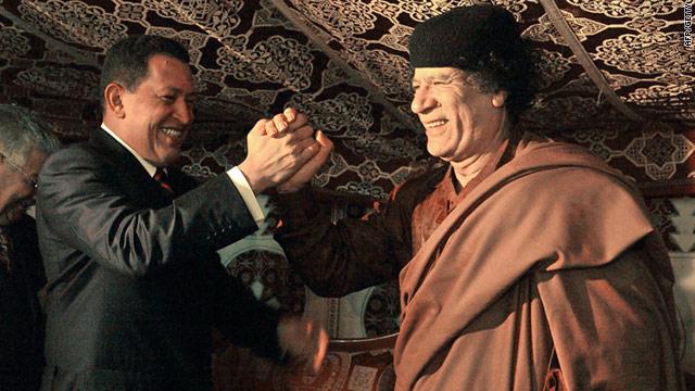 Old friends: Venezuelan president Hugo Chavez (left) meets Libyan leader Moammar Gadhafi in a tent in Tripoli, 2004.