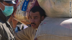 A man fleeing Libya crosses the border into Tunisia on Sunday.