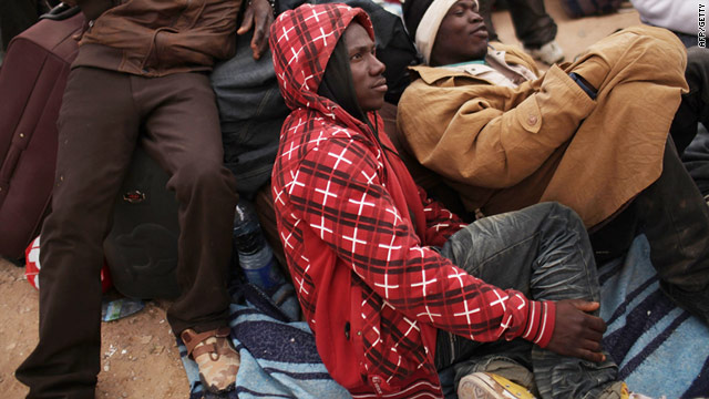 Migrants at a camp in Tunisia having crossed from Libya -- there are reports of violence against sub-Saharan Africans in Libya.