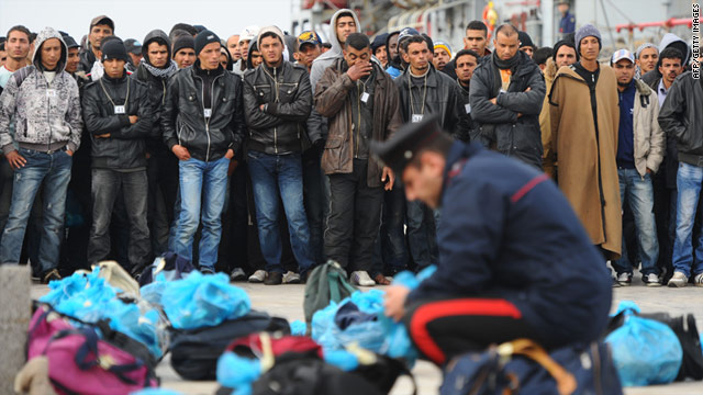 A policeman checks the belongings of Tunisian would-be immigrants on March 15, 2011 in Lampedusa, Italy.