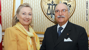 U.S. Secretary of State Hillary Clinton meets with Tunisian interim President Foued Mebazaa in Tunis on Thursday.
