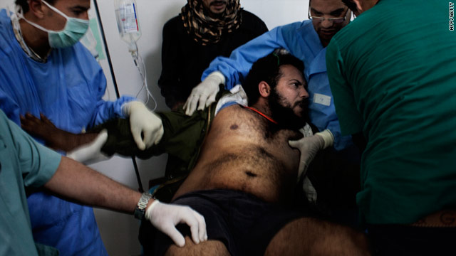 Doctors treat a wounded fighter in a Ras Lanuf hospital March 6. Medics in Misrata have complained of a lack of anesthesia.