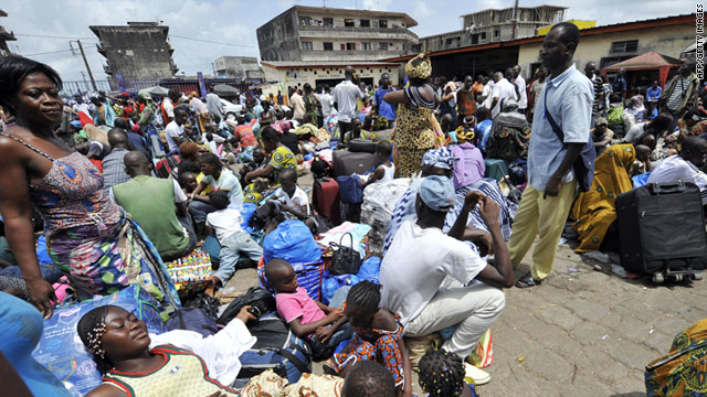 People wait at Adjame bus station for transport out of Abidjan and away from post-election violence, March 22, 2011.