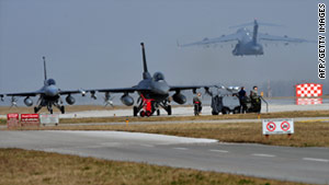 U.S. military aircraft are on the move at Aviano Air Base, in Italy, on Friday.