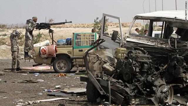Libyan rebels man a checkpoint in Uqayla, 20 kilometres east of the town of Ras Lanuf, Libya.