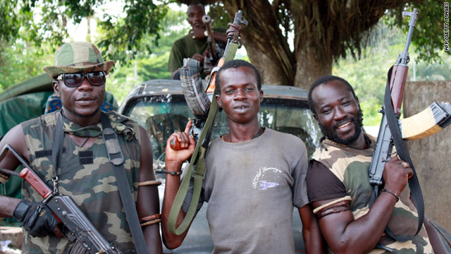 Pro-Ouattara forces are pictured with their weapons on Tuesday, March 29 in western Ivory Coast.