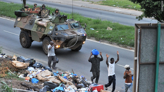 French military mission troops patrol a street in Abidjan, Ivory Coast, on Friday.