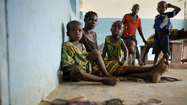 Refugees from Ivory Coast rest in a village in southern Liberia in this photo dated March 24.