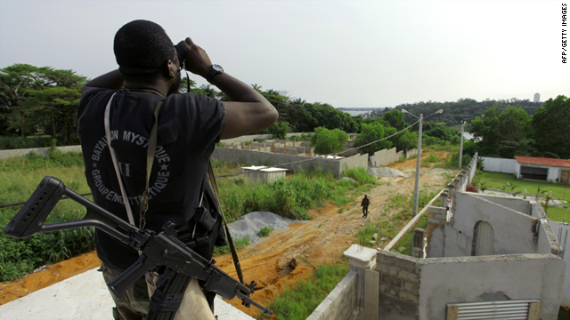 A member of Ouattara forces looks through binoculars ahead of an attack on Laurent Gbagbo's Abidjan residence Wednesday.