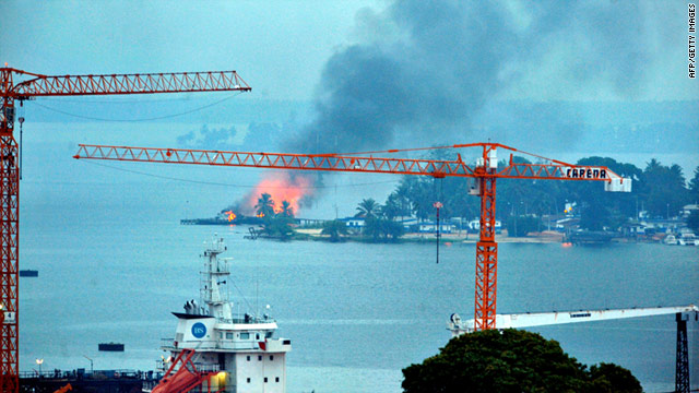 A fire is seen at a naval base controlled by forces loyal to strongman Laurent Gbagbo in Abidjan, Ivory Coast, on Sunday.