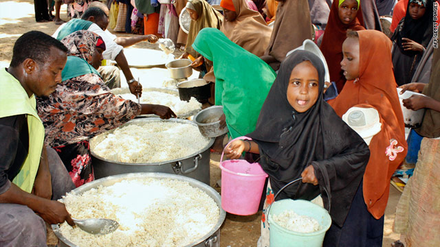 Photo on March 23, 2011, shows displaced Somali children receiving food-aid at a distribution centre in the wartorn capital, Mogadishu.