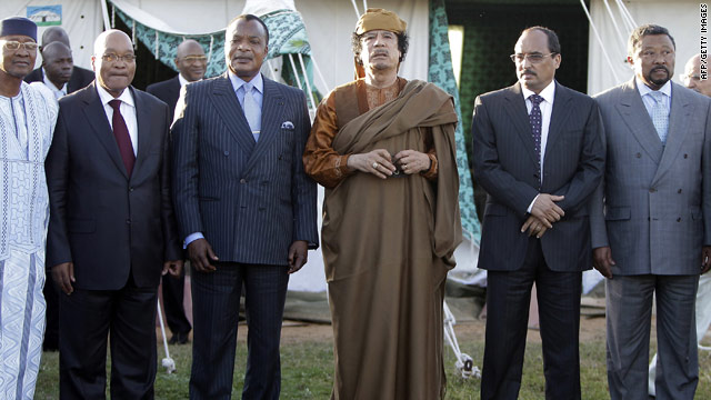 Moammar Gadhafi, third from right, stands Monday with the African Union delegation trying to mediate the Libyan civil war.