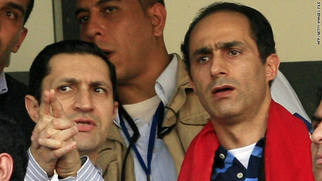File photo of Alaa, left, and Gamal Mubarak, sons of former Egyptian president Hosni Mubarak, attending a football match on January 31, 2010..