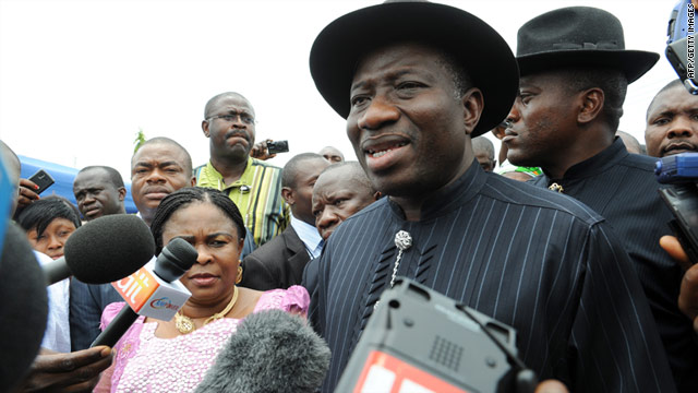 Nigerian President Goodluck Jonathan stands beside his wife, Patience, after voting on Saturday.