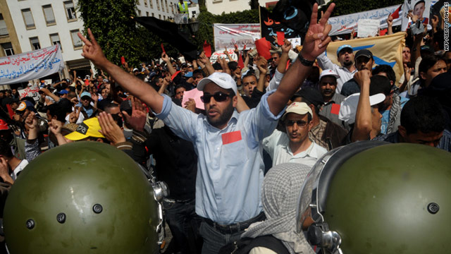 Protesters shout slogans during a demonstration in Rabat on April 8, 2011
