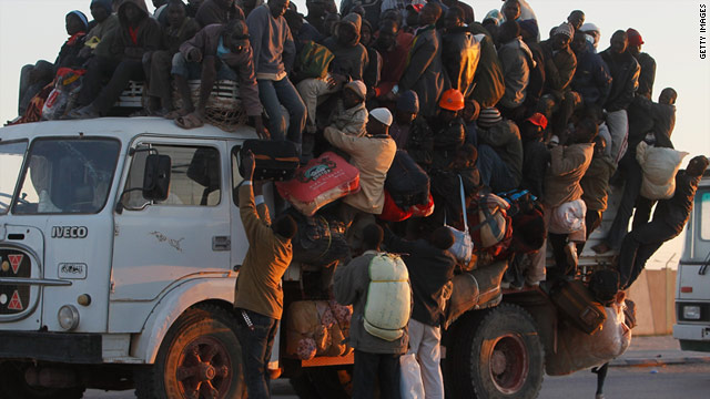 Foreign workers from other African countries scramble to board a truck trying to leave the besieged city of Misrata April 18.