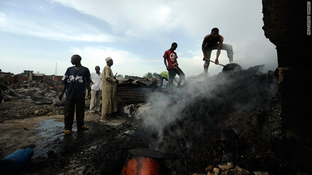 Deadly violence, such as this arson attack in Kaduna, has swept across northern Nigeria in the wake of the country's elections.
