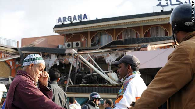 Marrakech residents stand in front of the Argana cafe on Friday, one day after the explosions.