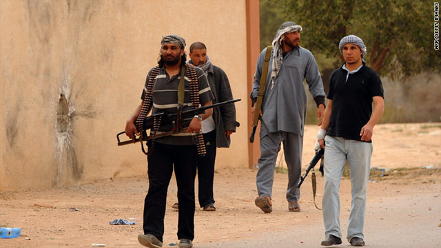 Libyan rebels on patrol near the airport at al-Ghiran close to the key port city of Misrata on April 30, 2011.