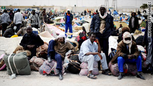 Refugees from Libya continue to pour into Tunisia to escape the fighting between rebels and pro-government forces.