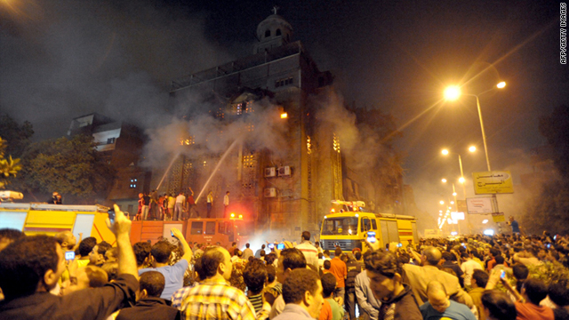 Egyptians gather as firefighters extinguish a blaze at a church following clashes at another church between Muslims and Christians in Cairo on Sunday.