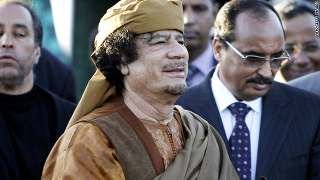 Libyan leader Moamer Kadhafi stands outside a tent erected at his Bab al-Aziziya residence in Tripoli on April 10, 2011.