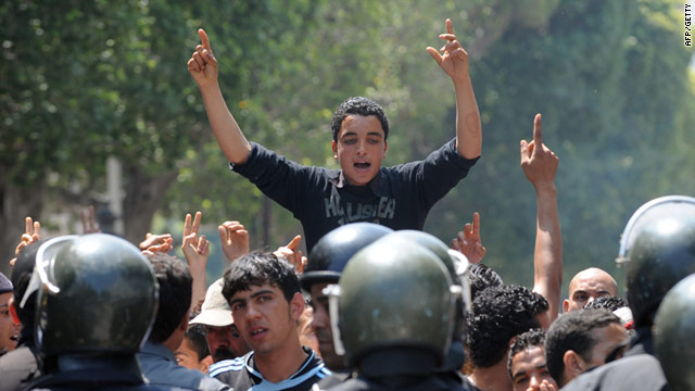 Tunisian riot police face protestors in Tunis on May 6, 2011 during a youth protest against the transitional government.