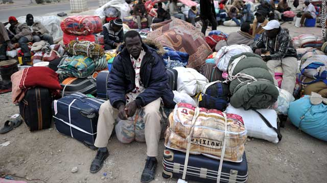 West African refugees wait to be evacuated near the port of Misrata, Libya, on April 30, 2011.