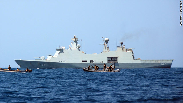 Undated photo released by NATO shows the Danish ship Esbern Snare and a suspected pirate skiff in the Gulf of Aden.
