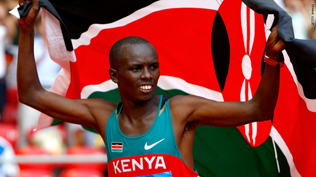 Samuel Wanjiru celebrates after winning the Men's Marathon in the National Stadium during Day 16 of the Beijing 2008 Olympic Games on August 24, 2008 in Beijing, China.