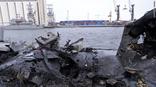 Picture shows damages at the port of Tripoli on May 20 after NATO warplanes hit eight vessels.