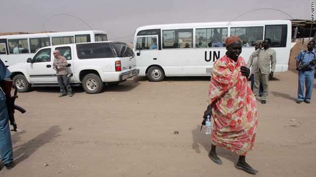 Armed guards stand next to U.N. vehicles at Mandela camp for displaced southern Sudanese, south of Khartoum.
