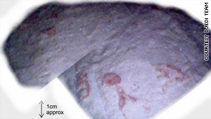 A close-up view of the red marks on the floor in the pyramid