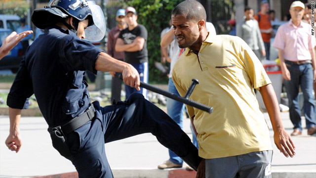 A police officer kicks a demonstrator during a protest in Rabat, Morocco, last week.