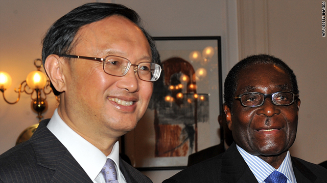 China's Foreign Minister Yang Jiechi with Zimbabwean president Robert Mugabe during his visit on February 11, 2011 to Harare.