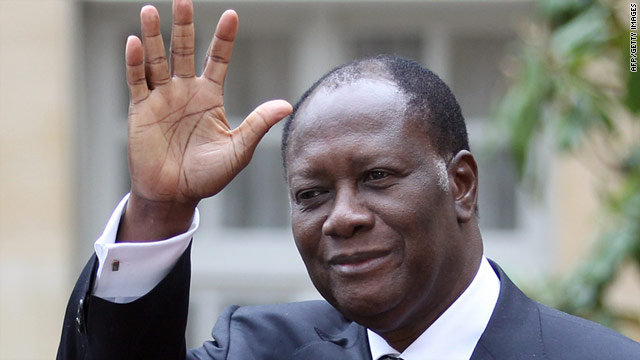 Ivory Coast's President Alassane Ouattara waves before a meeting last month in Paris with French PM Francois Fillon.