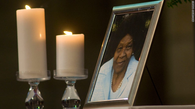 Two candles are placed next to a photograph of anti-apartheid activist Albertina Sisulu, who died on June 2, 2011.
