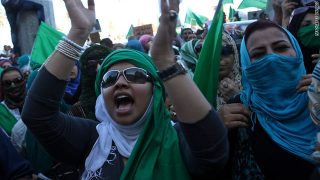 Supporters of Libyan leader Moammar Gadhafi demonstrate in Tripoli on Friday.