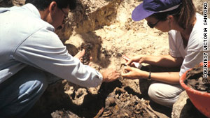 Victoria Sanford exhumes a mass grave in Guatemala in 1994 with Fernando Moscoso, founding president of the Guatemalan Forensic Anthropology Foundation.