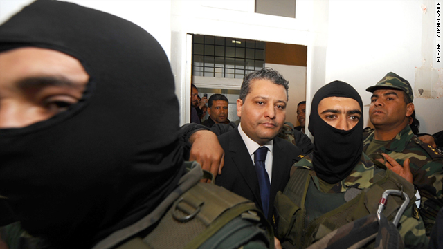 Imed Trabelsi, center, as seen on April 20 at the palace of justice in Tunis on arrival in court on drug charges.