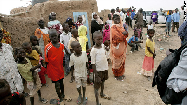 Children and women at Mandela camp for displaced southern Sudanese, 30 kms south of the capital Khartoum, on May 22.