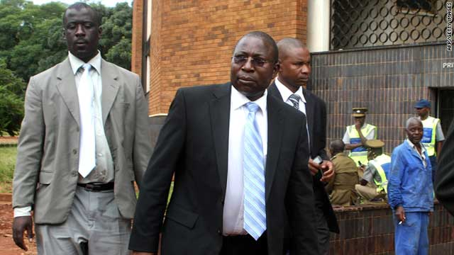 Zimbabwe's Energy Minister Elton Mangoma (center) arrives at the Harare Magistrate's court on March 11, 2011.