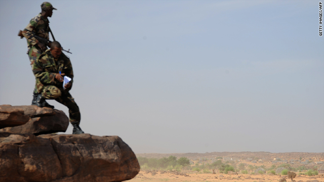 Mauritanian soldiers look on during the Africa Eco Race, on January 05, in Guelb Agantour, Mauritania.