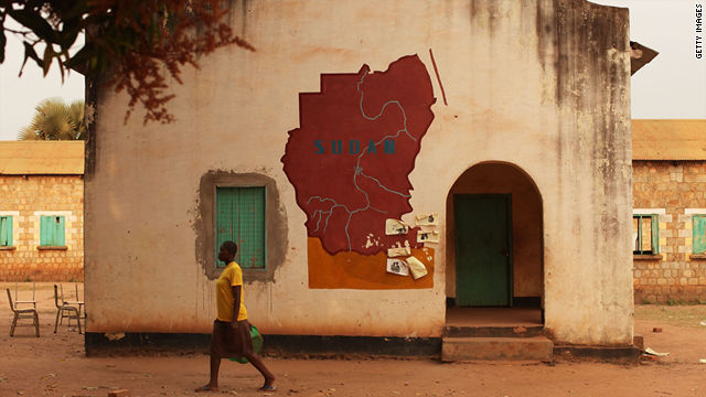A woman walks by a building with a map of Sudan painted on it in the town of Yambio, south Sudan, on January 15.