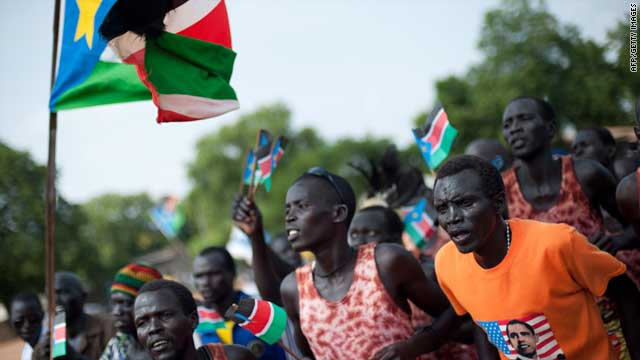 People dance and celebrate during a rally organised by the Sudan People's Liberation Movement in Juba on July 5, 2011.