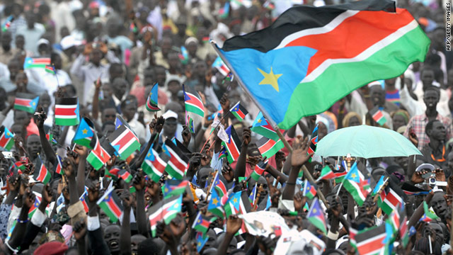 Southern Sudanese wave the national flag of the world's newest country, South Sudan, on Saturday.