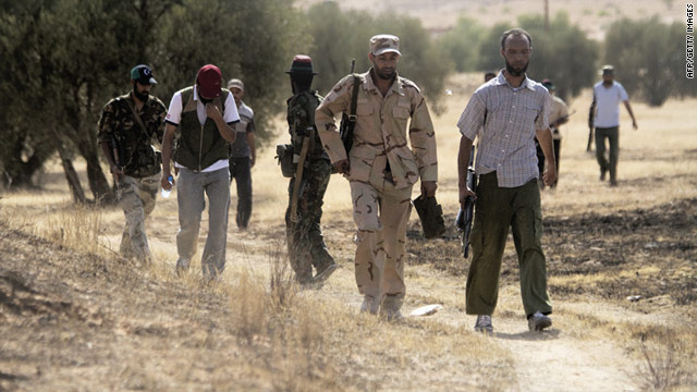 Libyan rebels near the hill village of Kikla, during an offensive by forces loyal to Moammar Gadhafi on July 13.