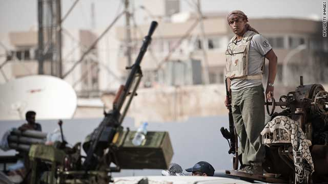 A Libyan rebel prepares to drive towards the Brega frontline from Ajdabiya on July 14, 2011.